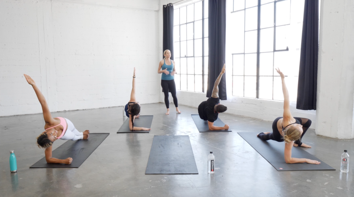 Nicole Duke leads hot pilates teacher training to 4 students on yoga mats
