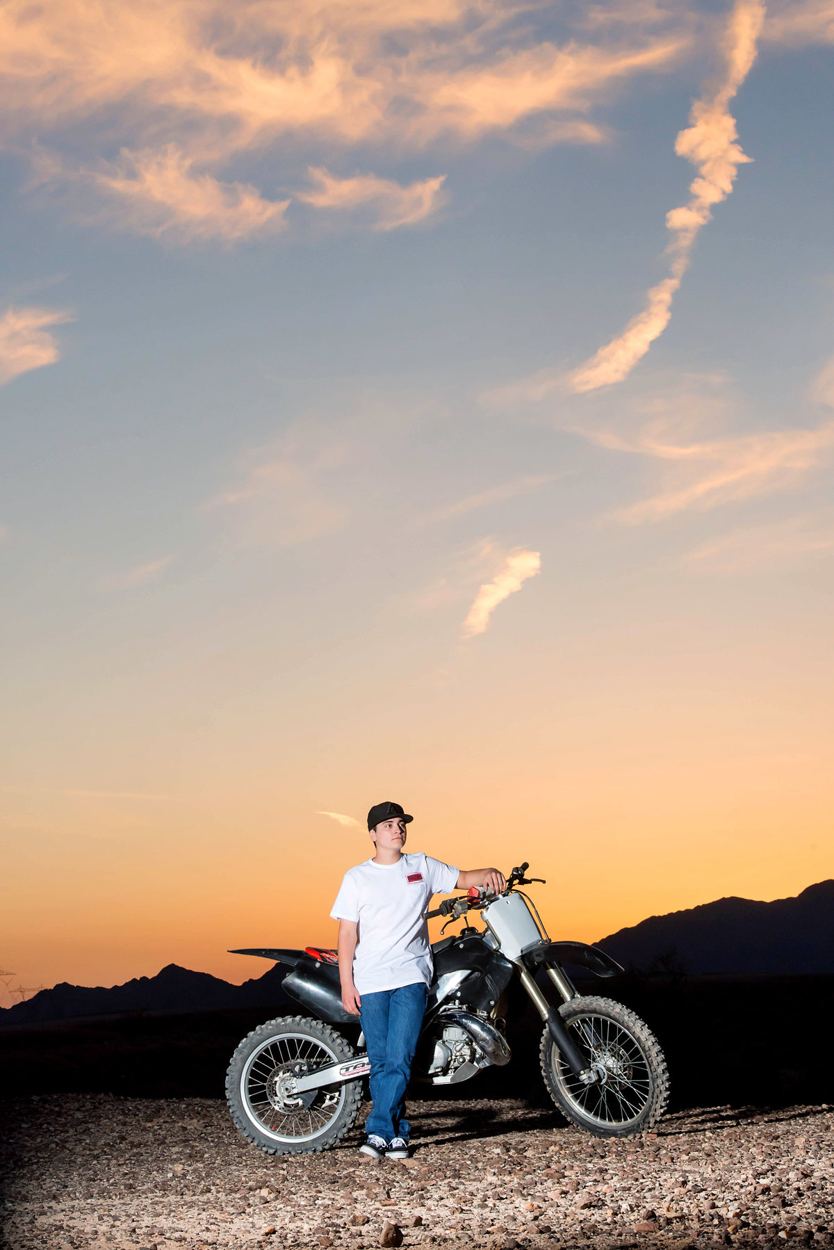 senior with dirt bike in desert