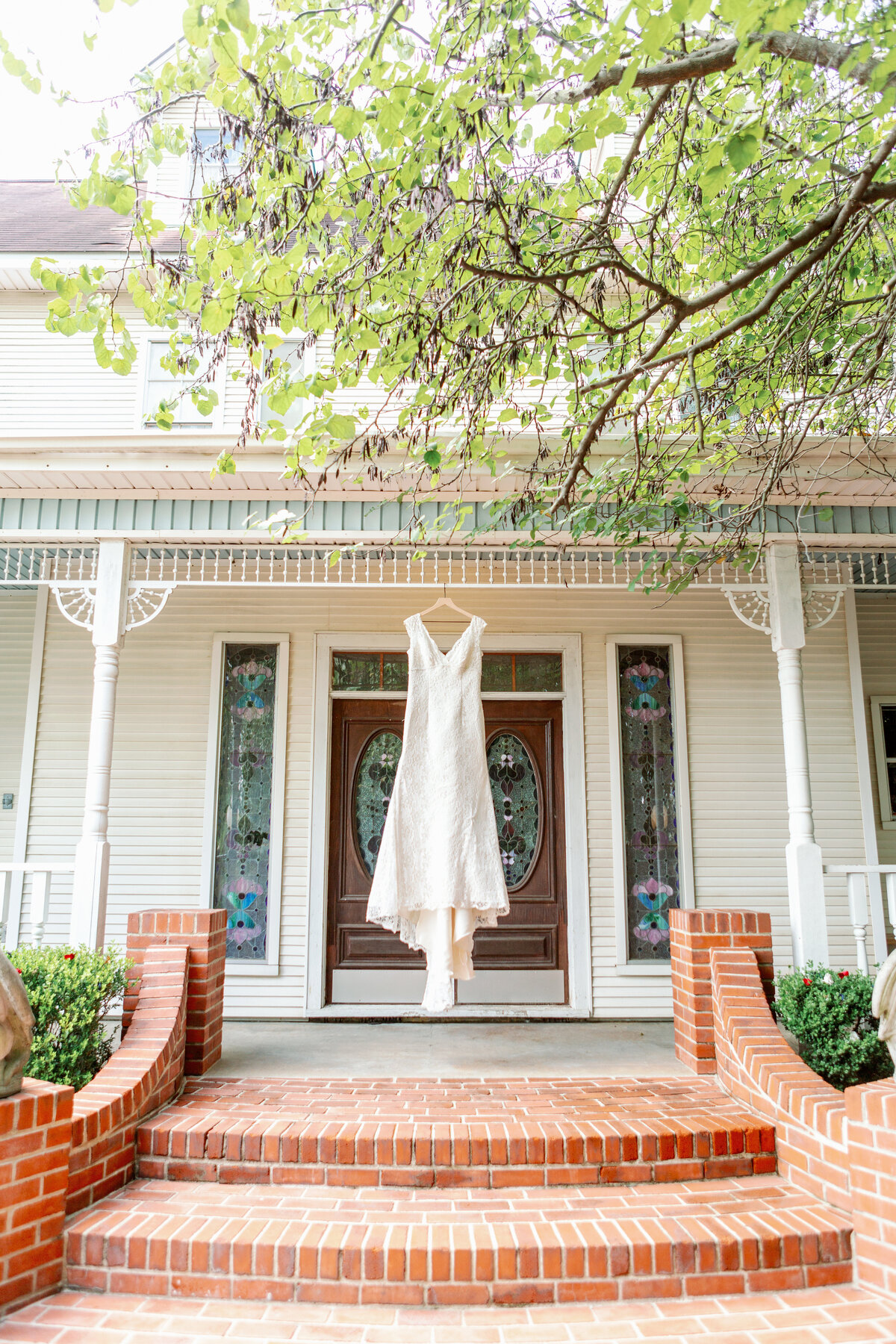 Wedding Gown Hanging in Front of Southern Home