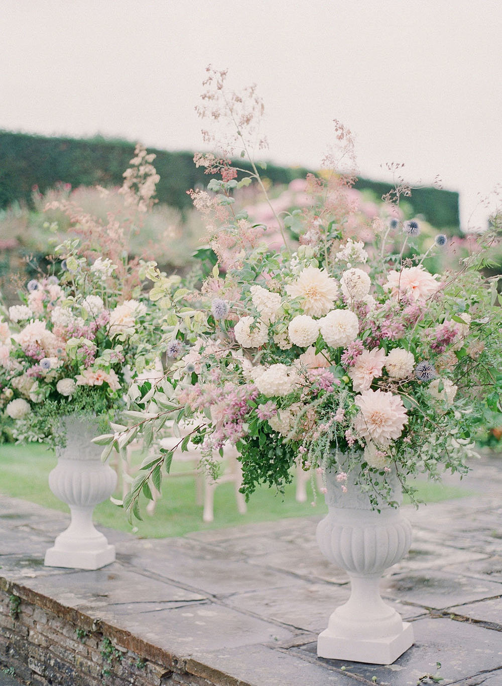 Grand, pastel garden-style floral arrangements for a luxury destination wedding in England at Hedsor House