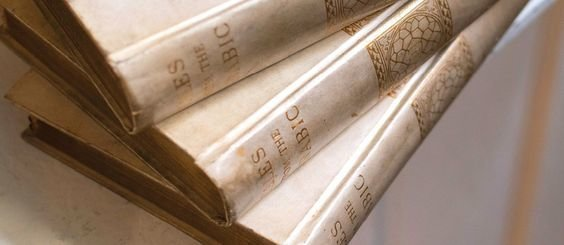 three velum gold books