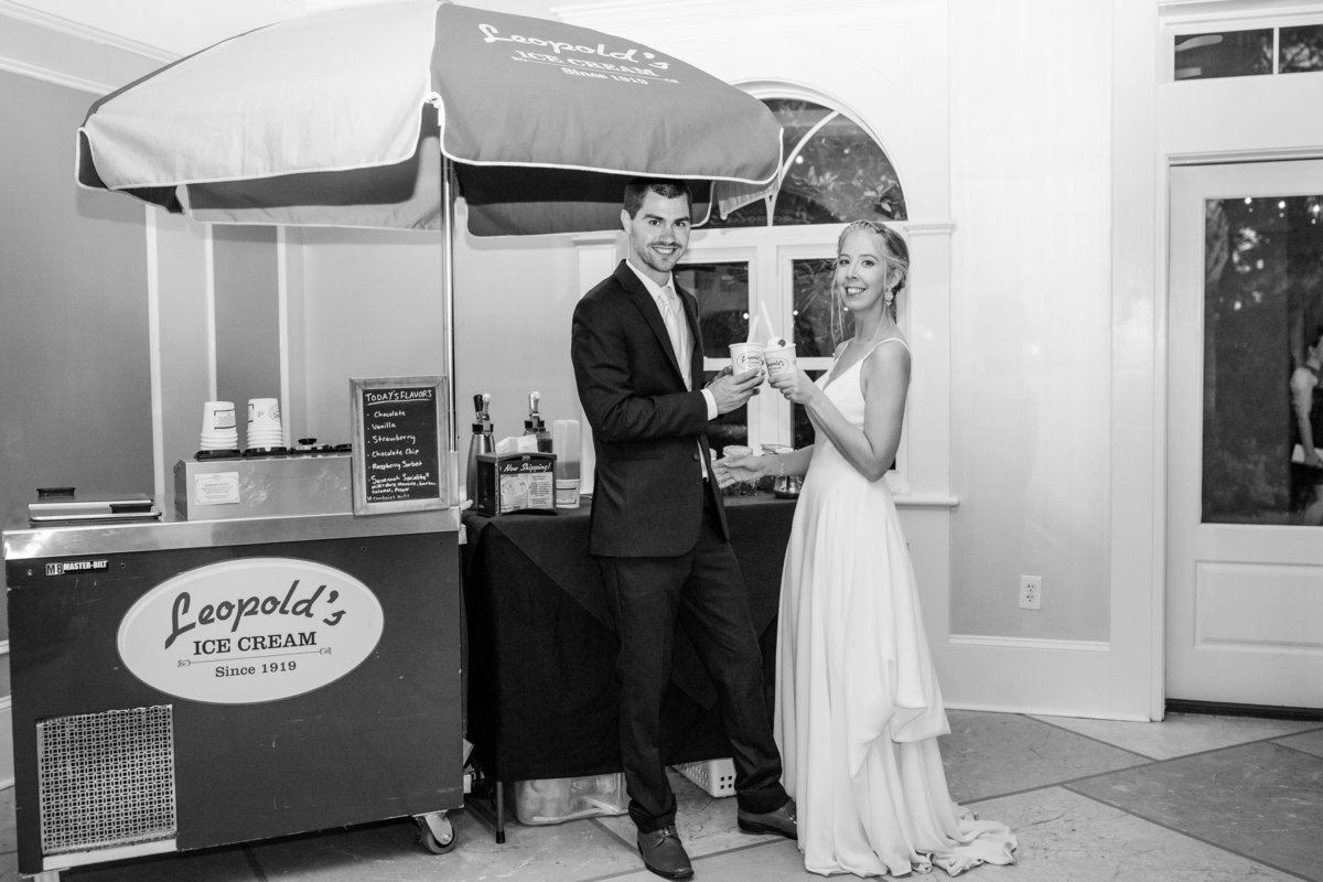 bride and groom eating leopolds ice cream at their savannah reception