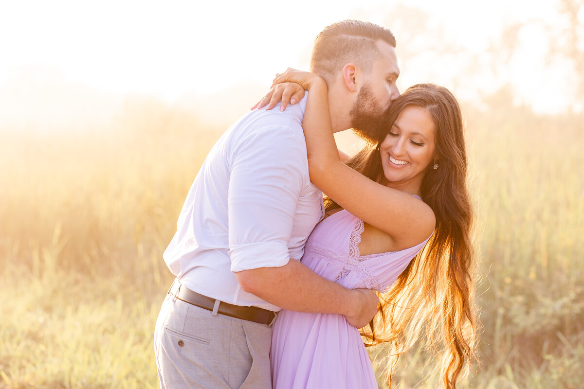 Summer Sunset Romantic Engagement Session in lavender maxi dress in field at Busch Wildlife in St. Louis by Amy Britton Photography Photographer in St. Louis