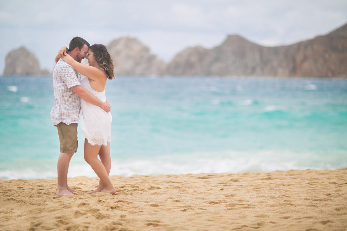 bride and groom on a beach in cabo for engagement photos