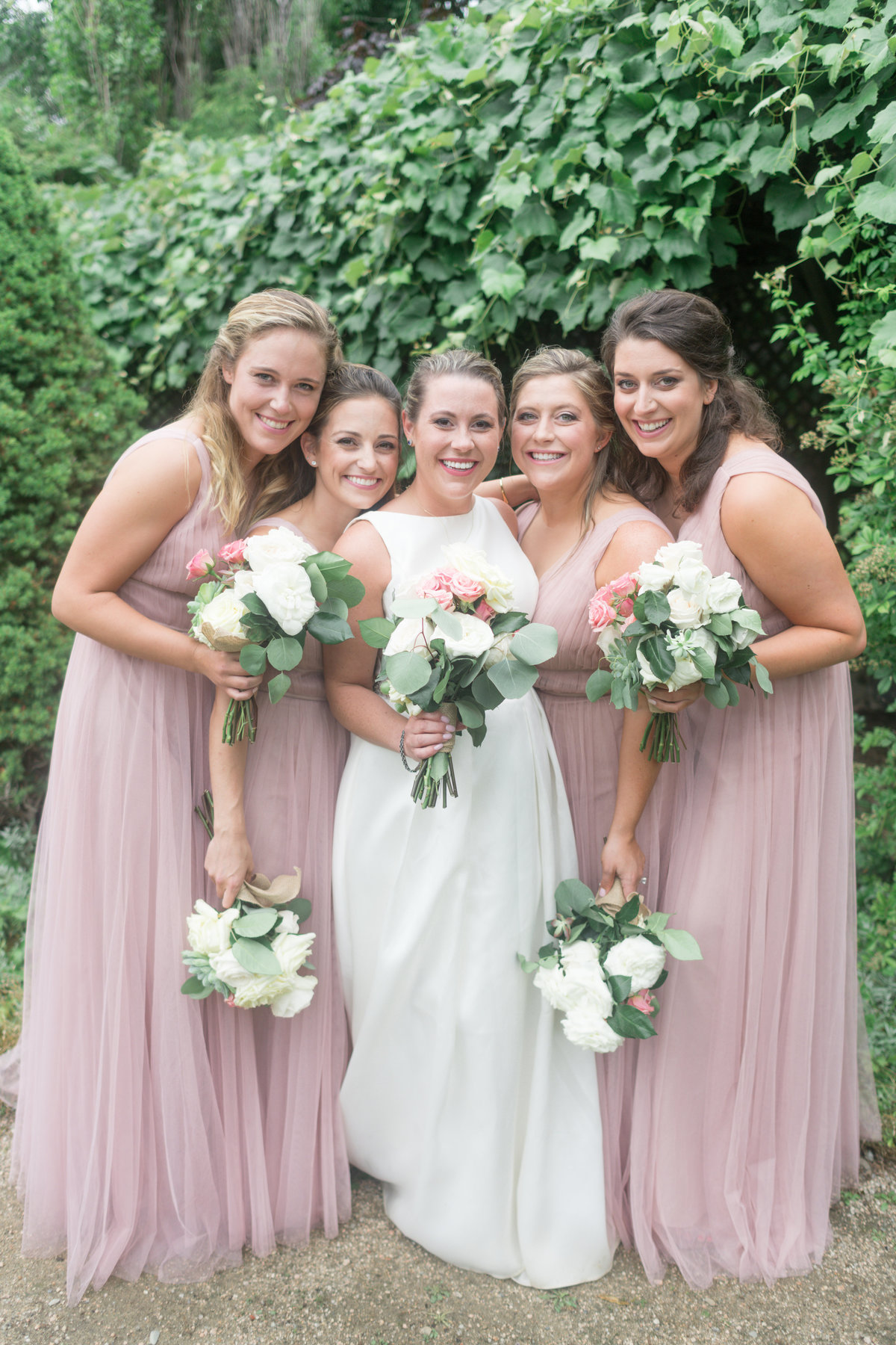 Bridal Party poses for photo in the secrete garden at the Castine Inn