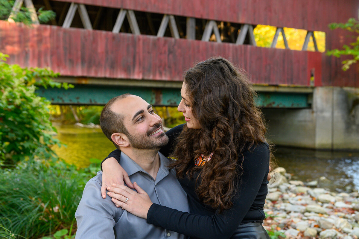 vermont engagement photos underneath covered bridge