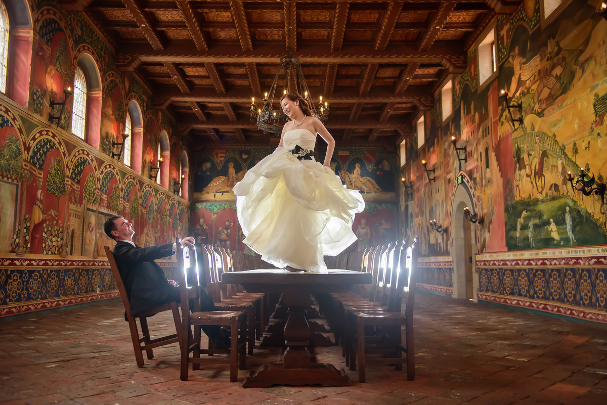 Bride dancing on table at Castello di Amorosa