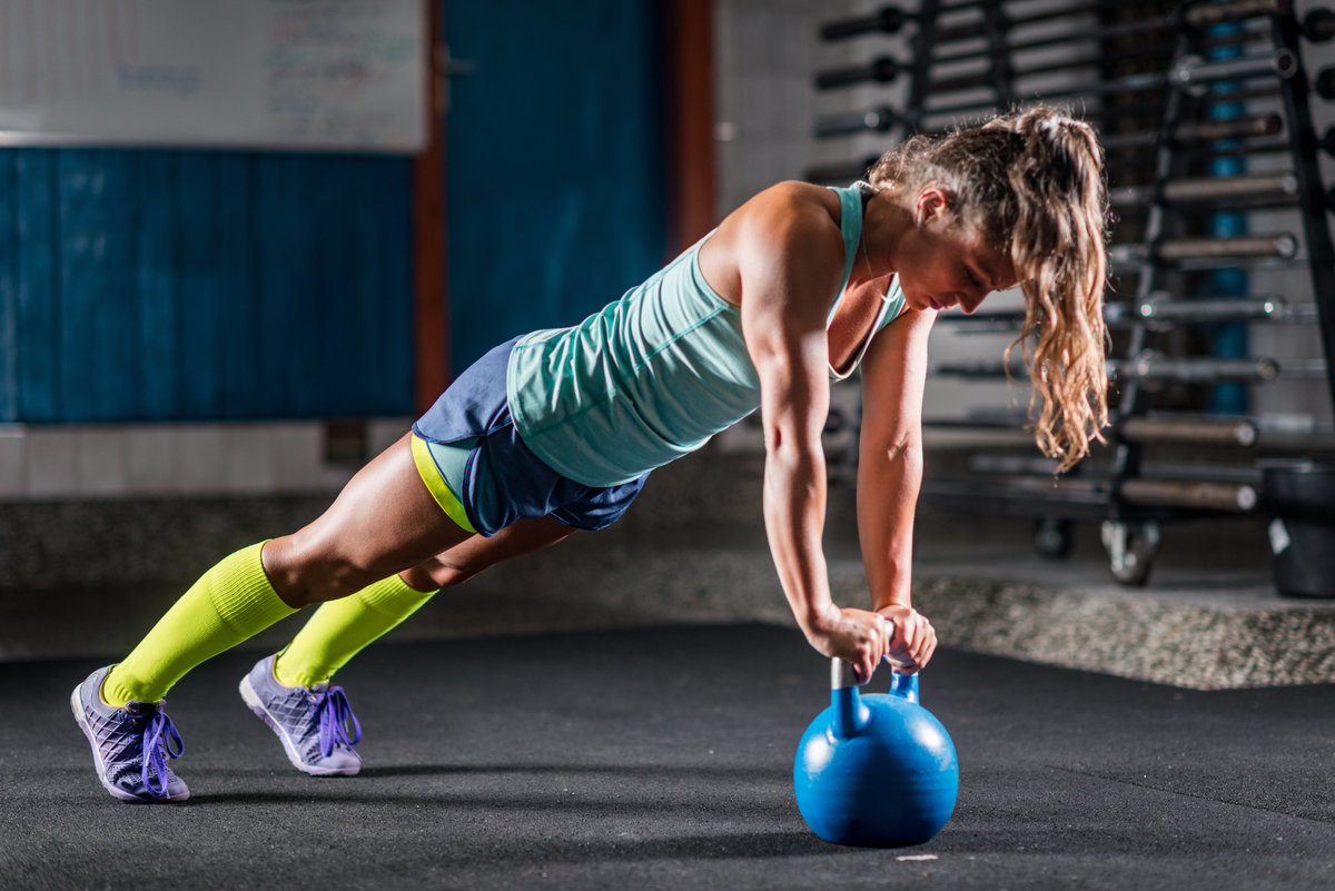 woman-athlete-exercising-with-kettlebell-las-vegas-personal-trainer