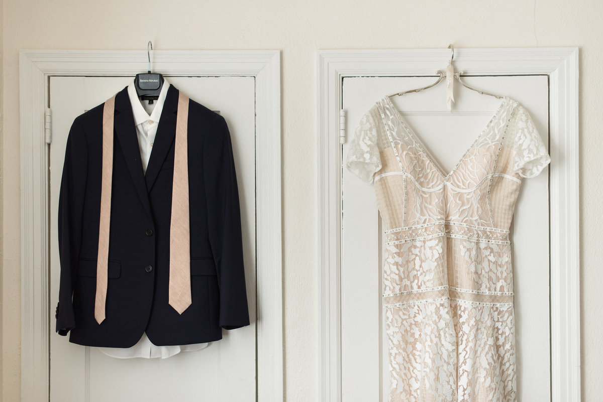 bride and groom attire hanging
