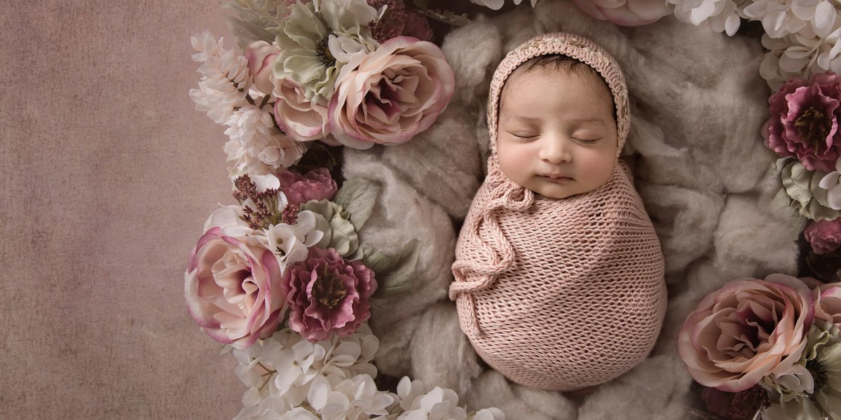 Little baby girl in pink with flowers