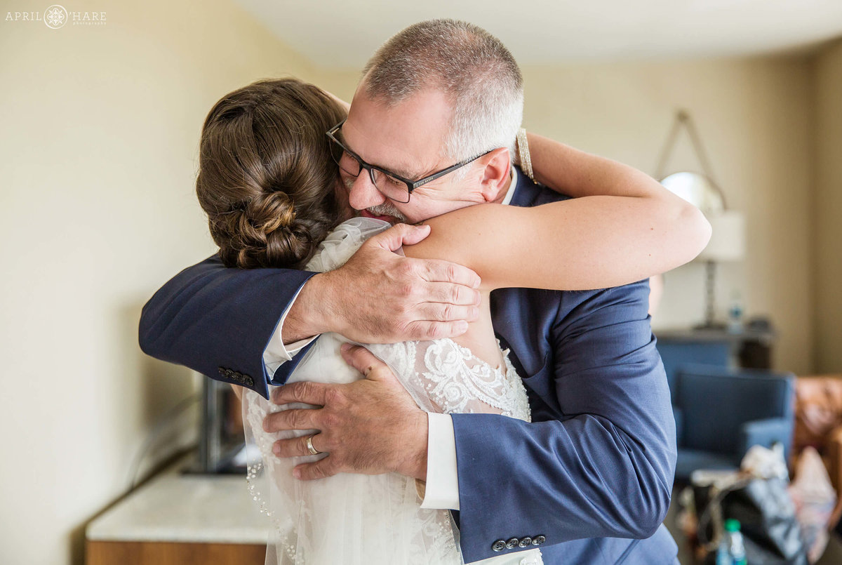 Bride has a first look moment with her dad on her Denver area wedding day