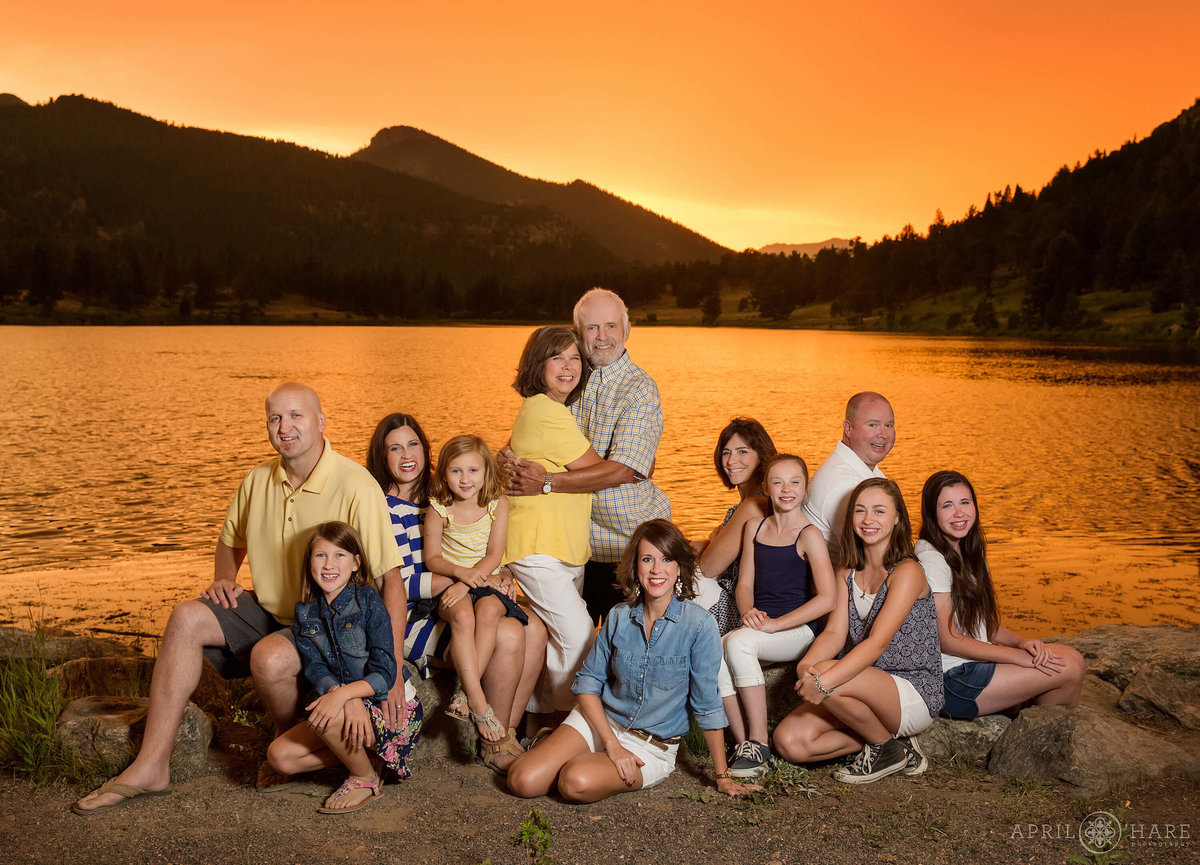 Orange sunset family photo at Lily Lake Rocky Mountain National Park in Estes Park CO