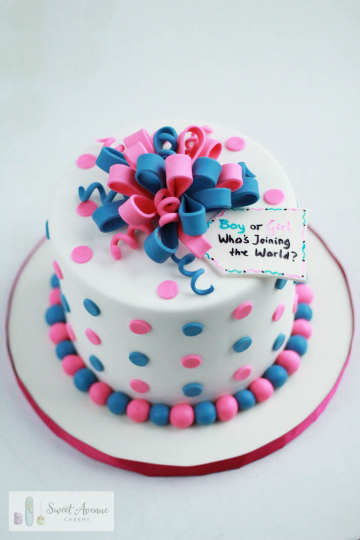 pink and blue present gender reveal cake