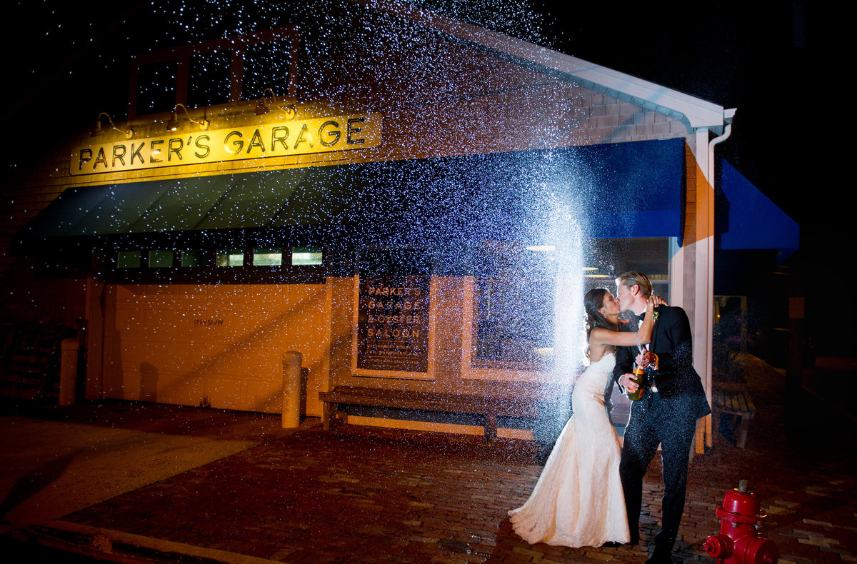 parkers garage wedding photo with champagne