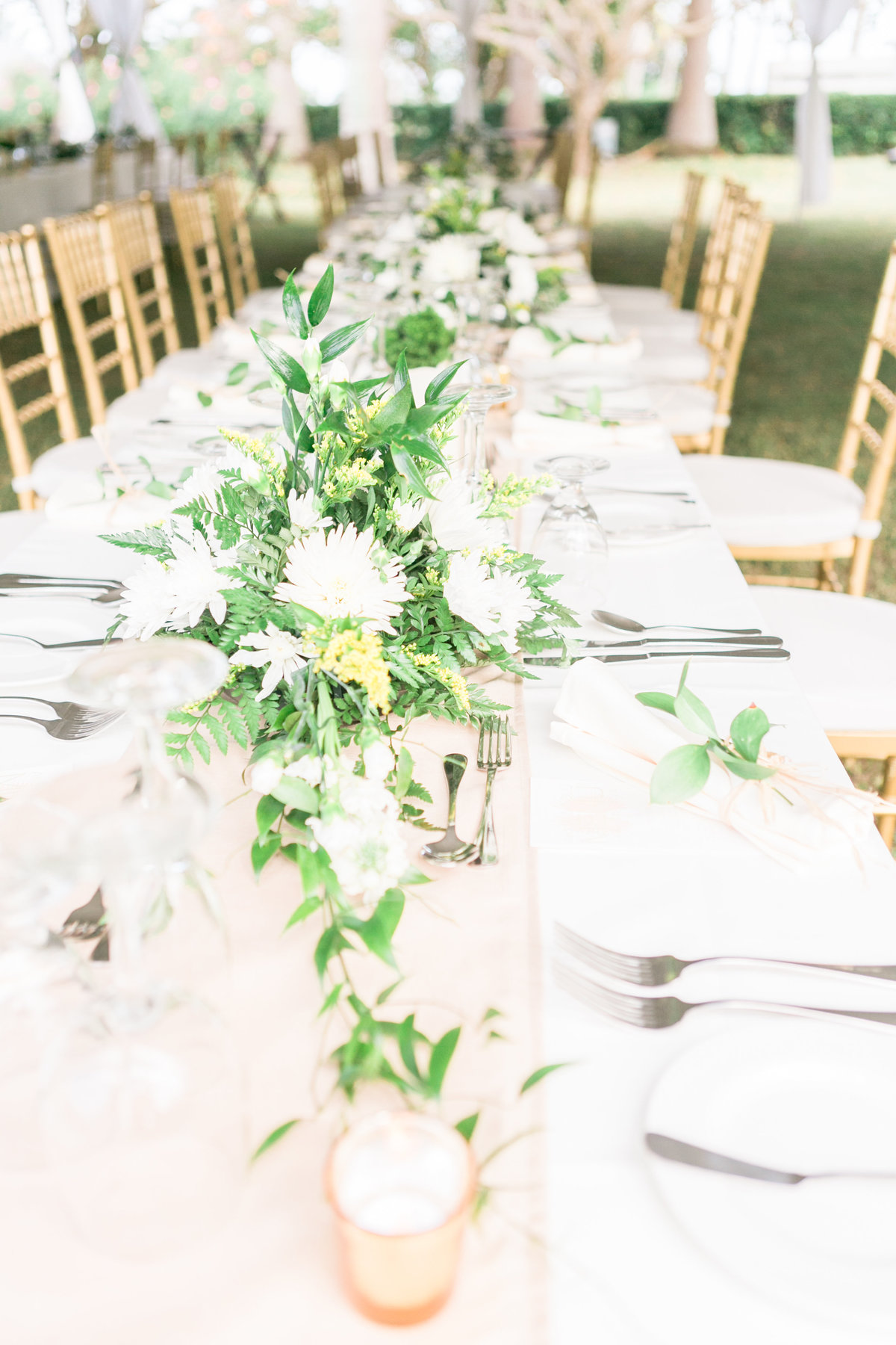 White and green wedding centerpieces at Barbados destination wedding