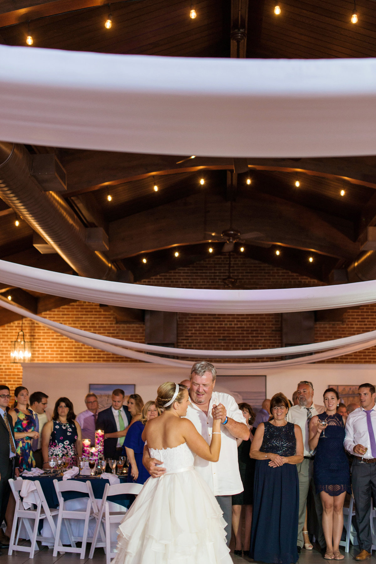 photo of bride dancing with dad during wedding reception at Pavilion at Sunken Meadow