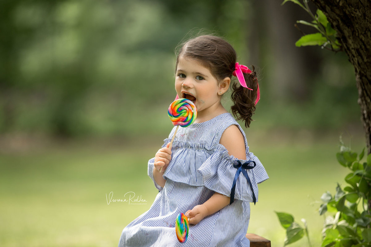 Happy child with her lollipop