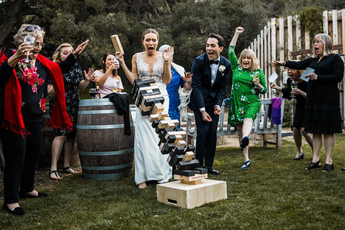 Bride plays jenga game at her temecula creek inn wedding in temecula, ca