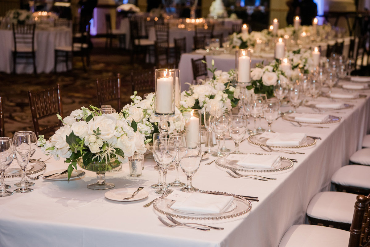 a wedding reception tablescape photo with white linen and white floral centerpieces with white candles at the JW Marriott Resort and Spa Las Vegas