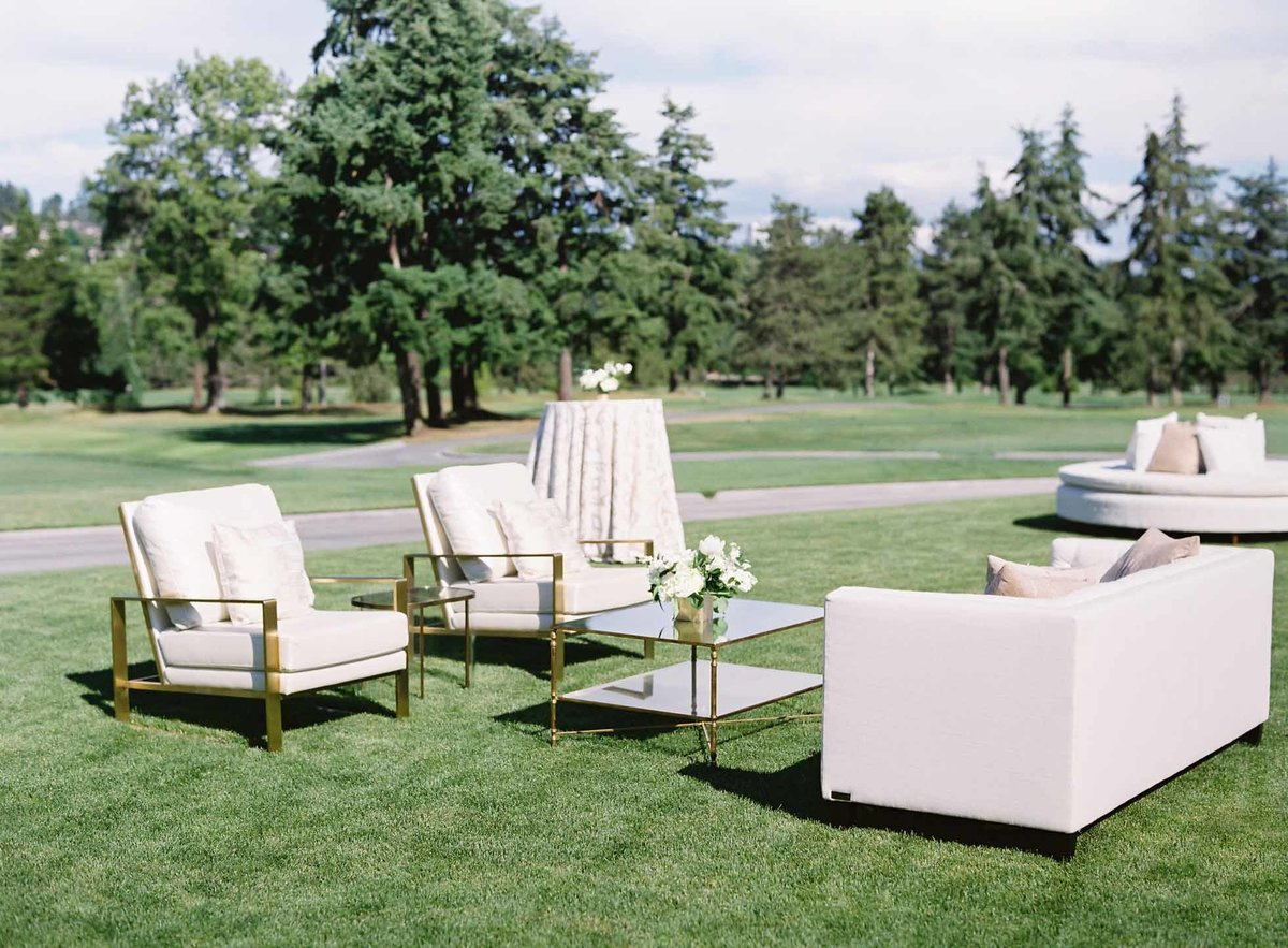 Elegant lawn seating for luxe wedding cocktail hour at Overlake Golf and Country Club
