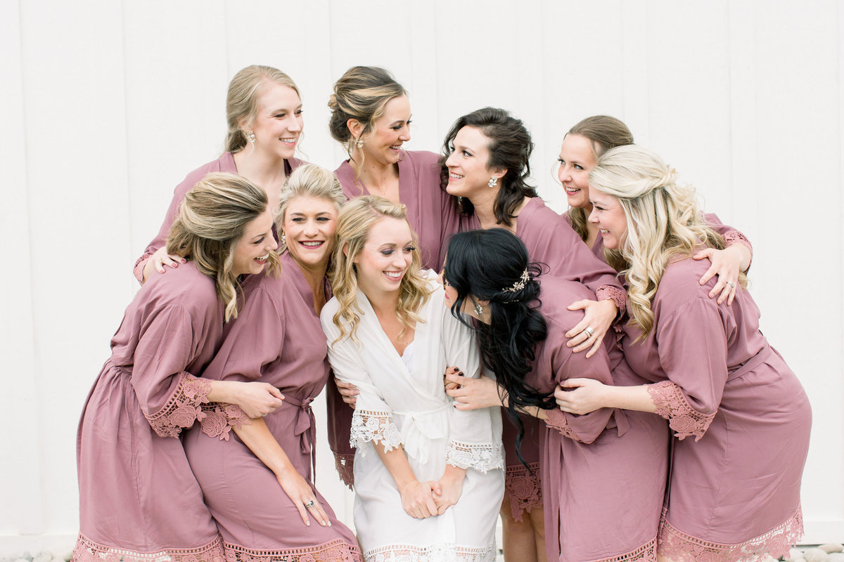 Bride getting ready with bridesmaids in matching robes
