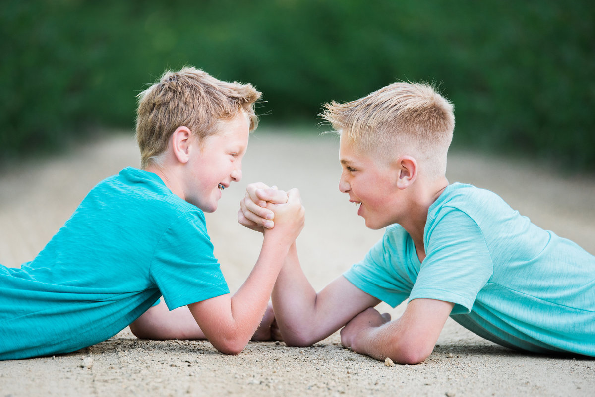 Photo of two young brothers arm wrestling  in Ellensubrg Washington