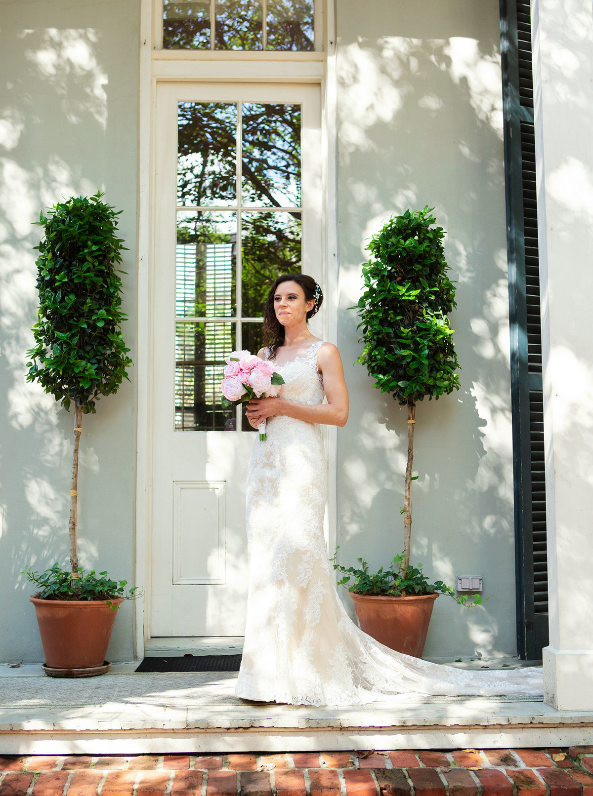 new orleans bride on The Terrell House porch looking at her groom