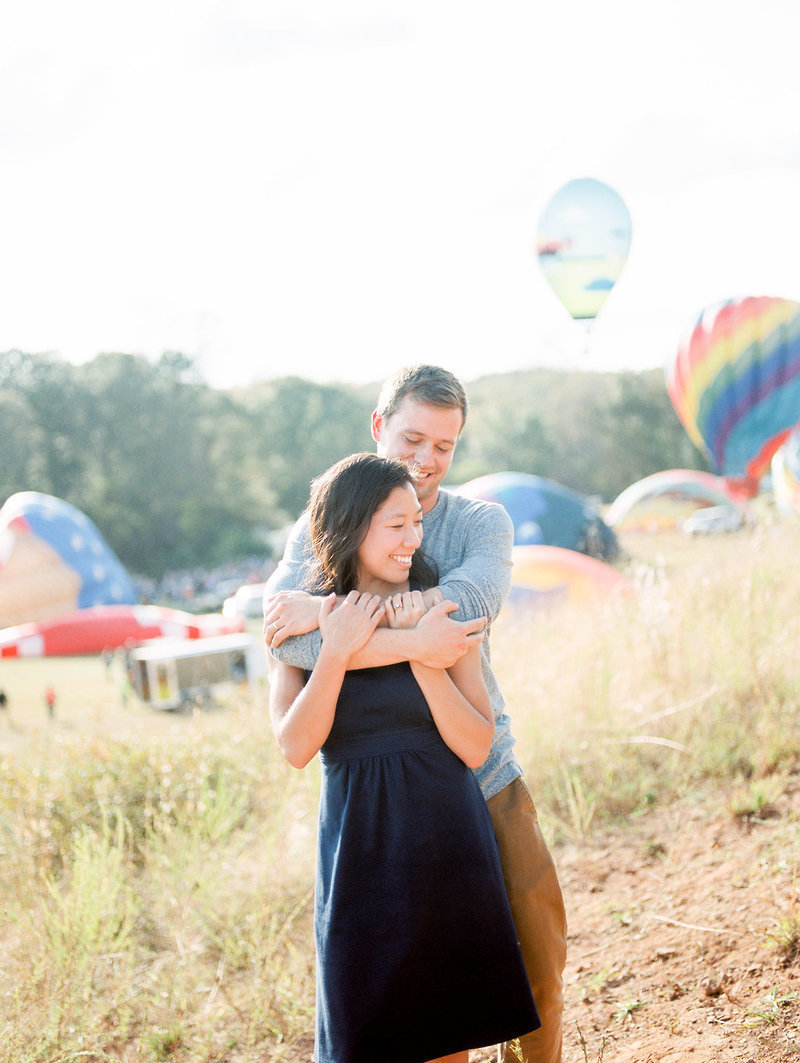 hot air balloon engagement couple