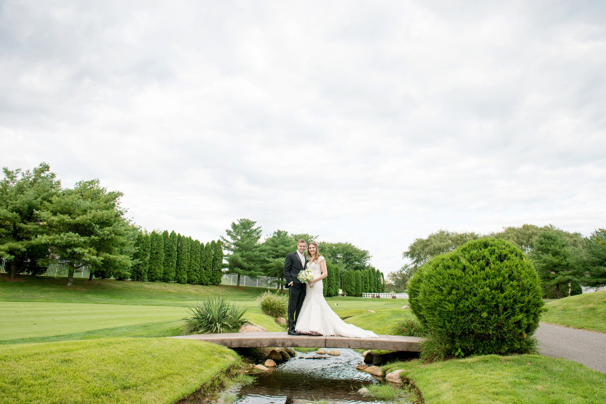 panoramic view of bride and groom on the golf course at Willow Creek Golf and Country Club