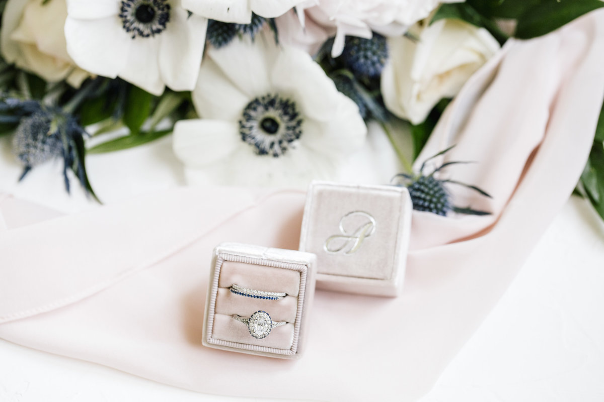 wedding rings on monogrammed box