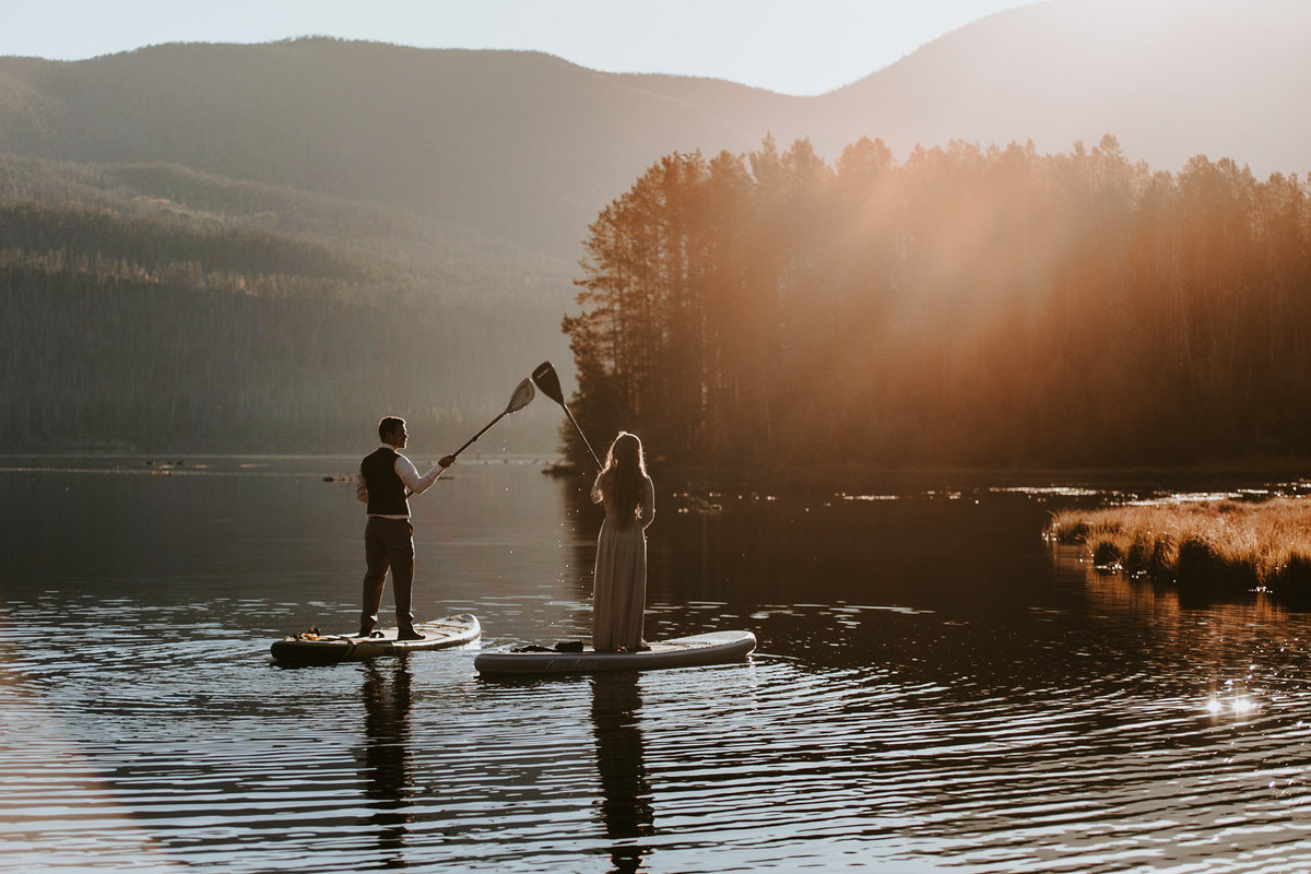 wedding couple paddleboarding on Grand Lake Colorado