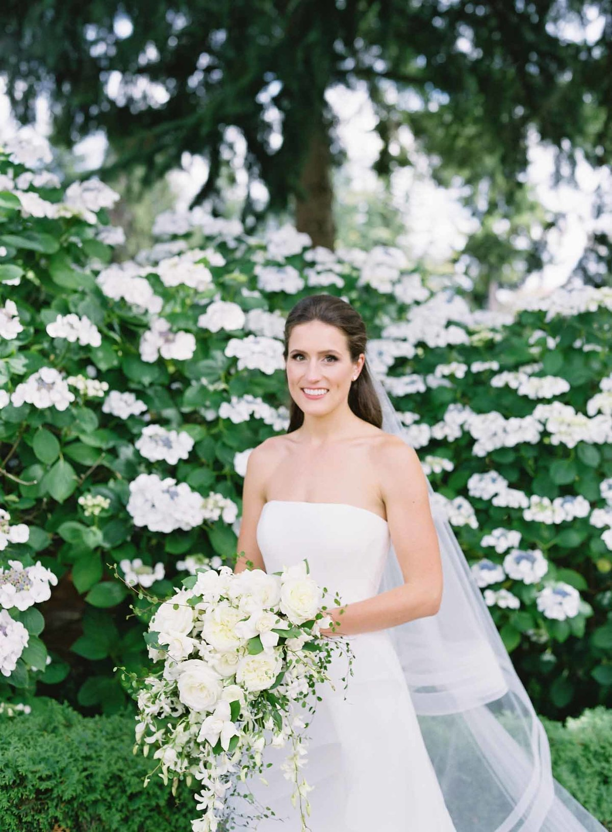 Kerry holding a lovely white cascade bouquet