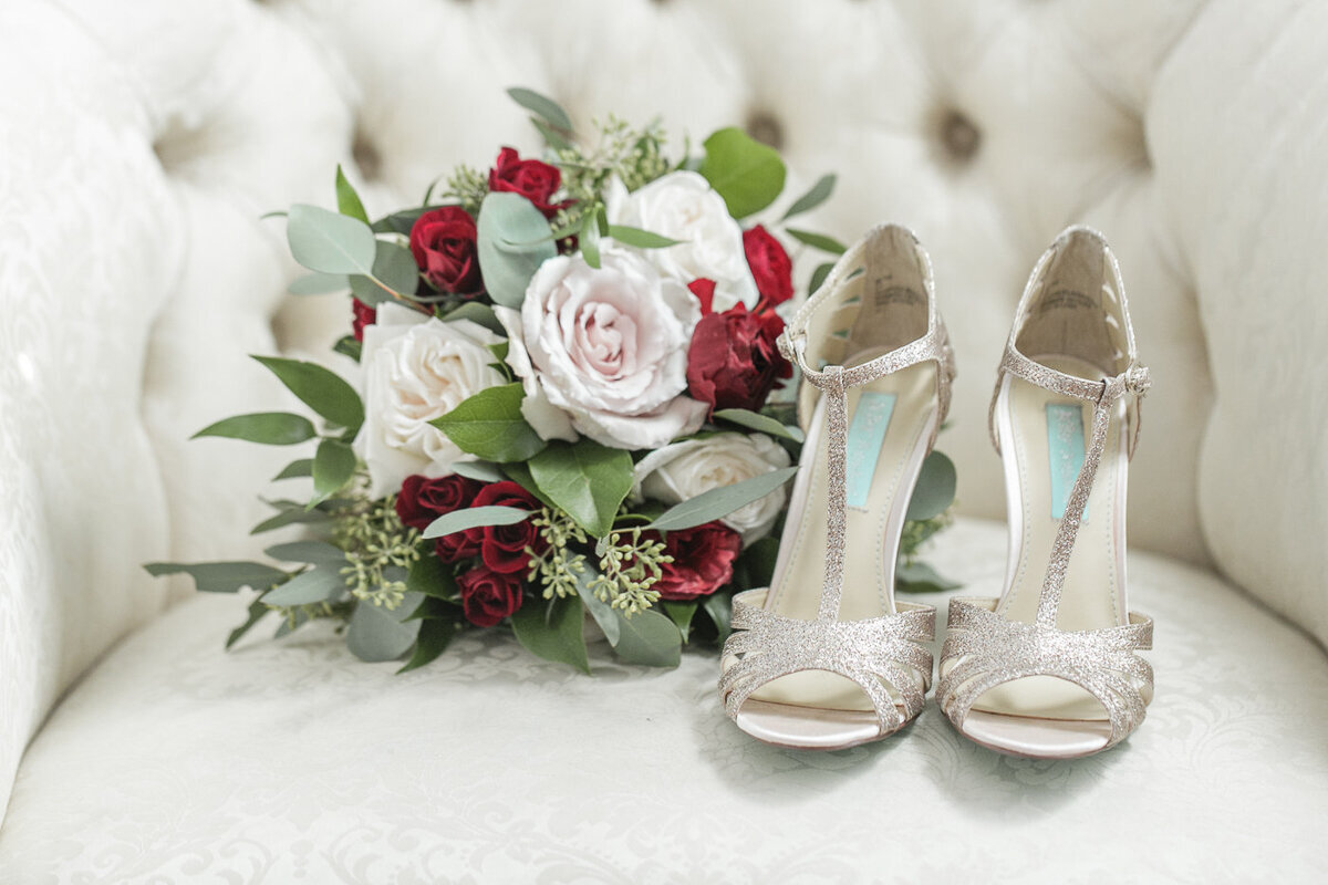 gold wedding shoes and bouquet