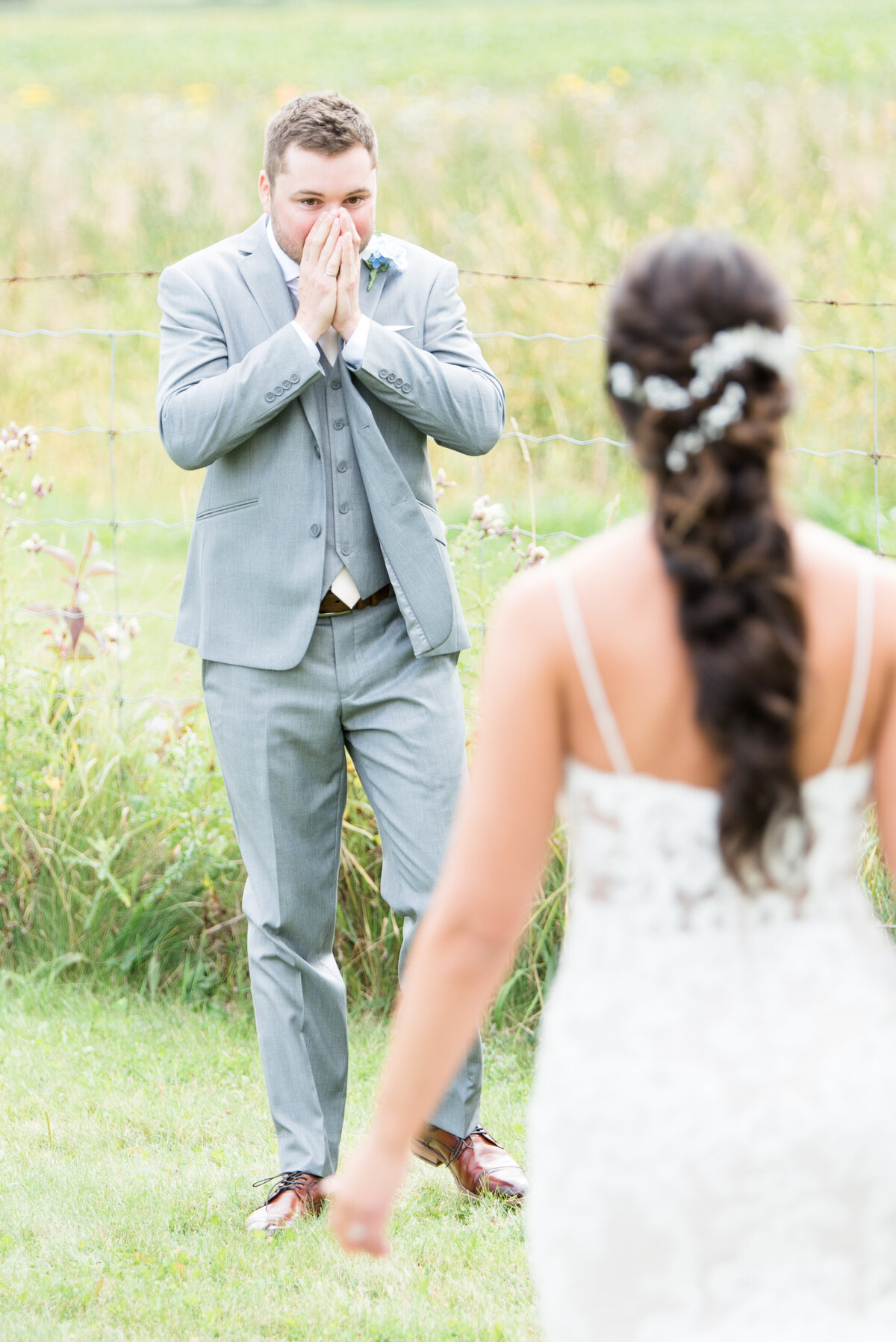 A groom is wowed by his bride during their first look in the Norwester Mountains