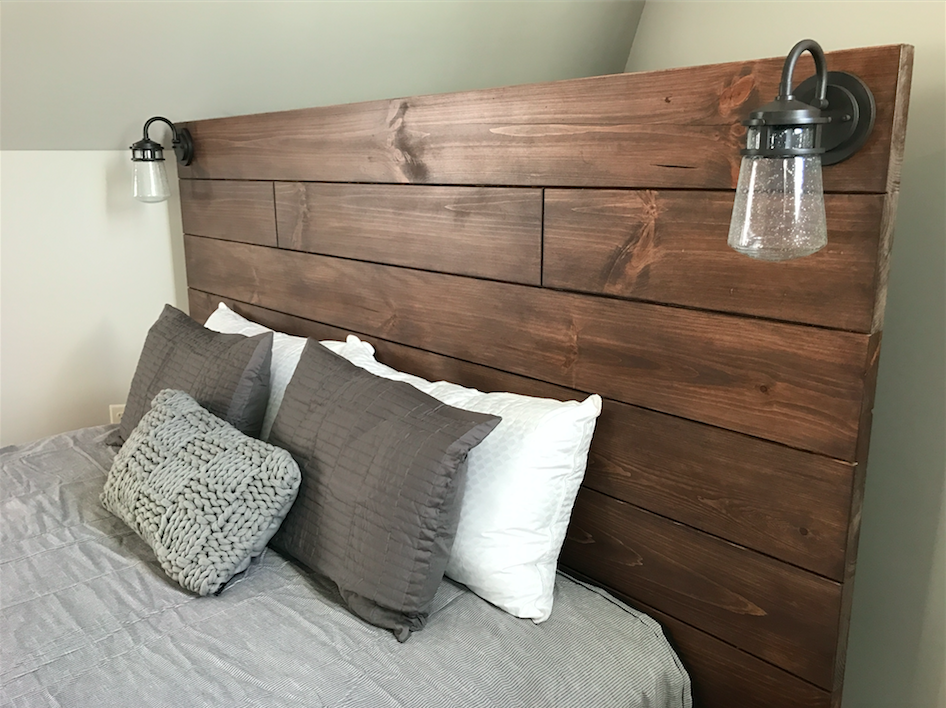 Rustic bed with built in lighting fixtures