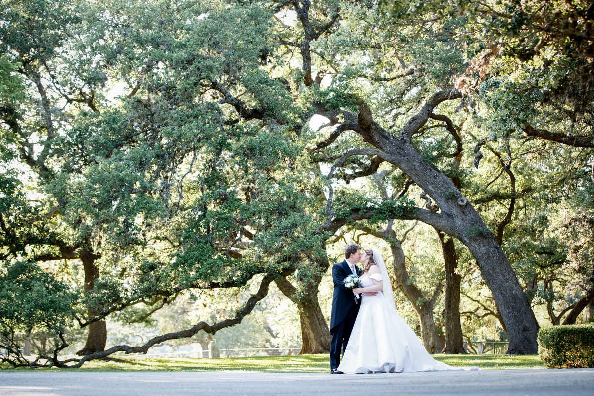 Austin wedding photographer castle avalon wedding photographer bride groom trees
