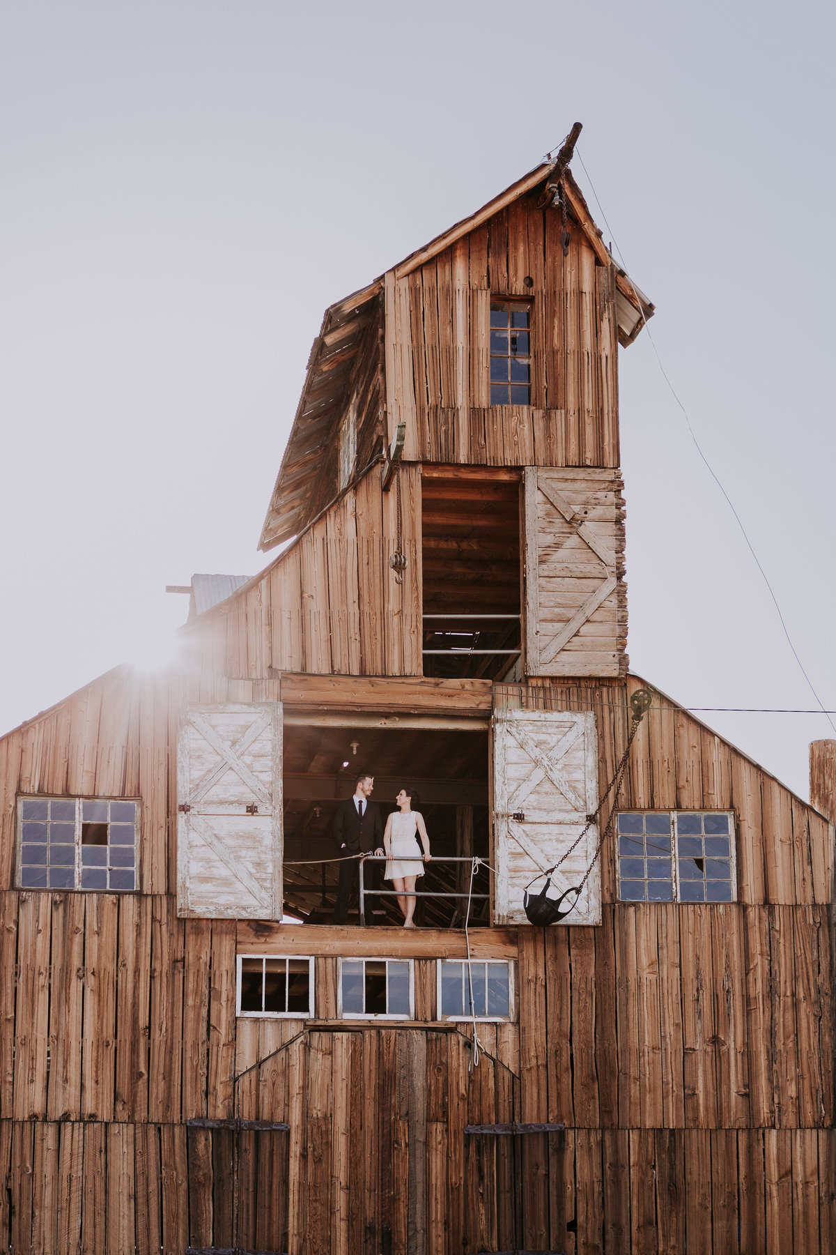 Lake Tahoe elopement photographers couple poses in tall barn