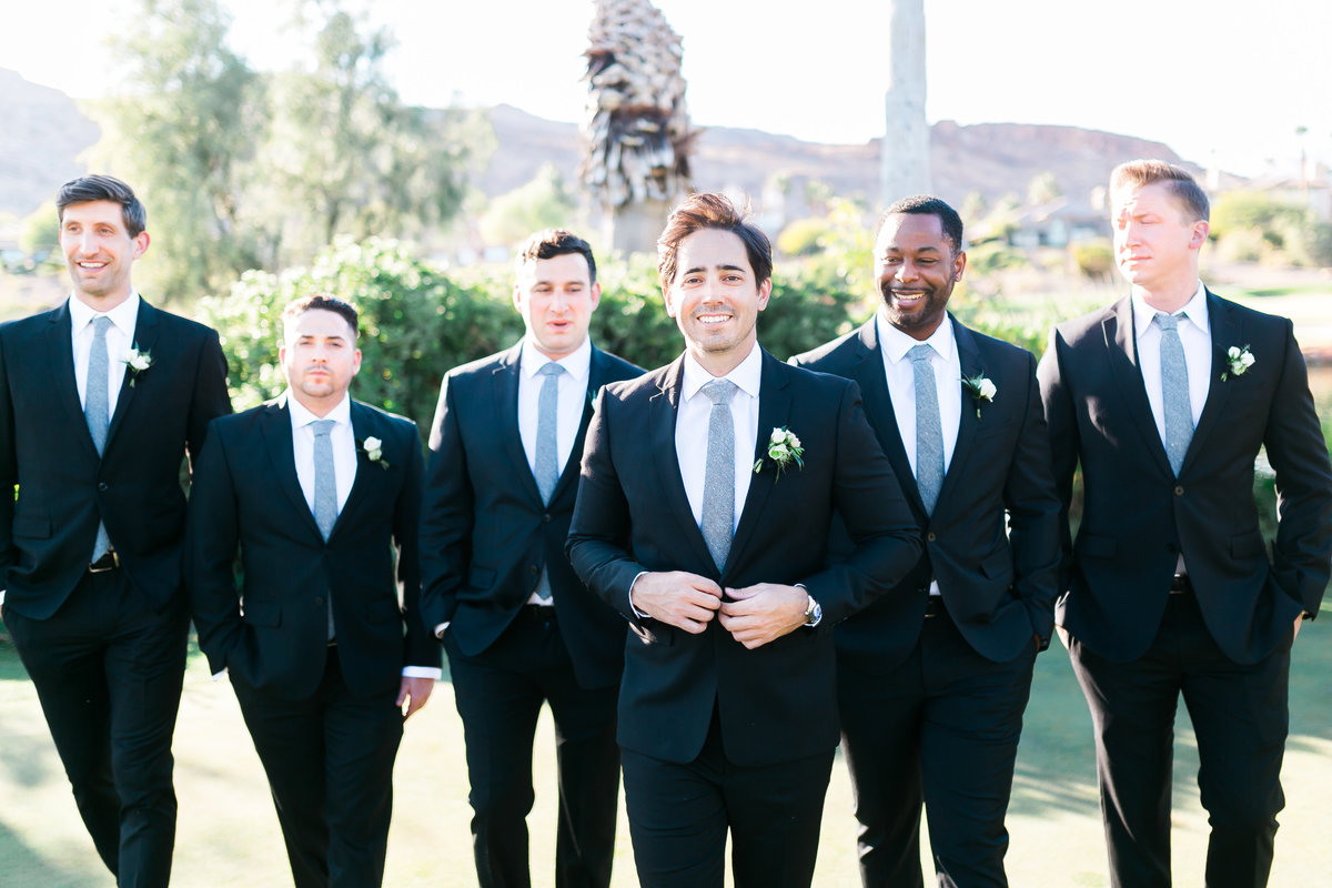 grooma nd groomsmen photo in black suits with grey ties and white boutonnieres at Red Rock Country Club in Las Vegas