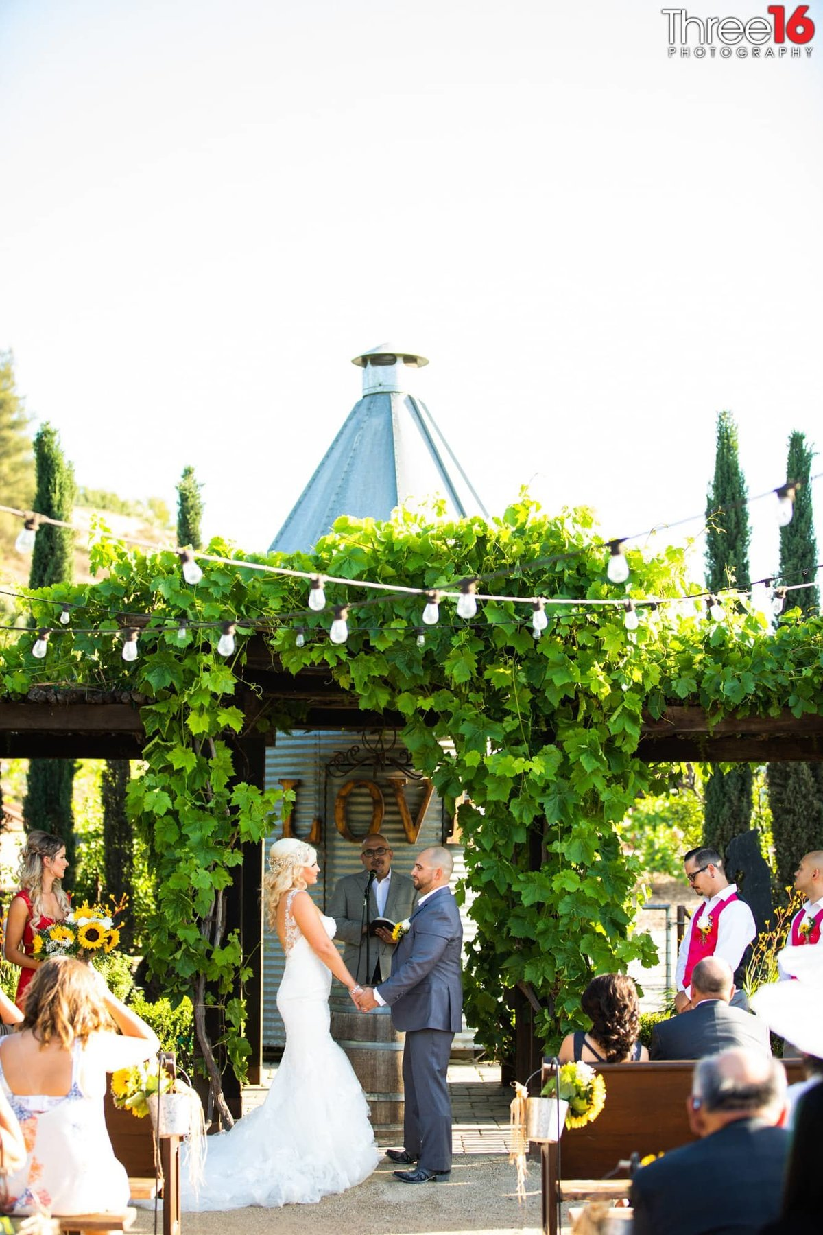 Peltzer Winery Wedding Venue Photography Temecula Bride and Groom Ceremony Vows