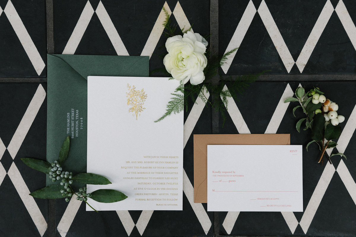 wedding invitation suite flat lay green and white