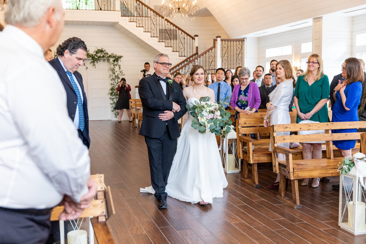 Bride Walking Up The Aisle in The Carriage House Chapel