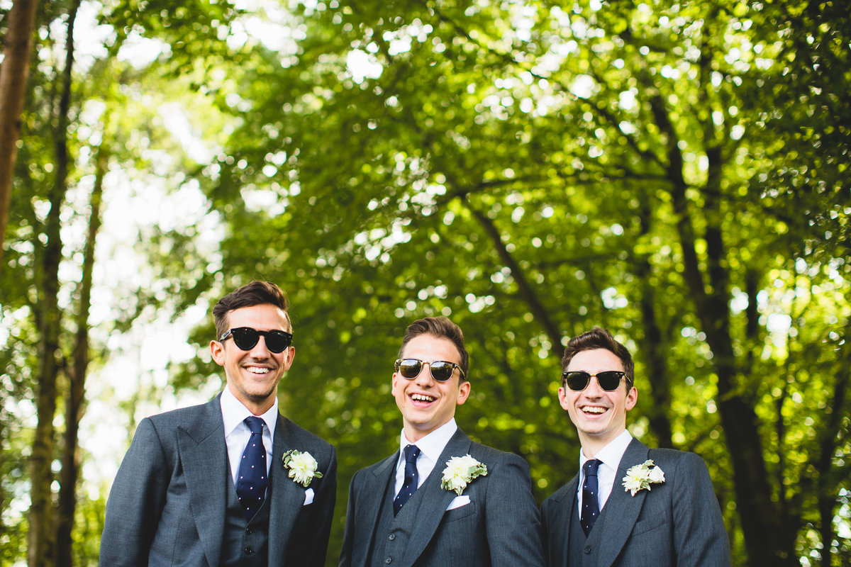groom and best men in ray bans
