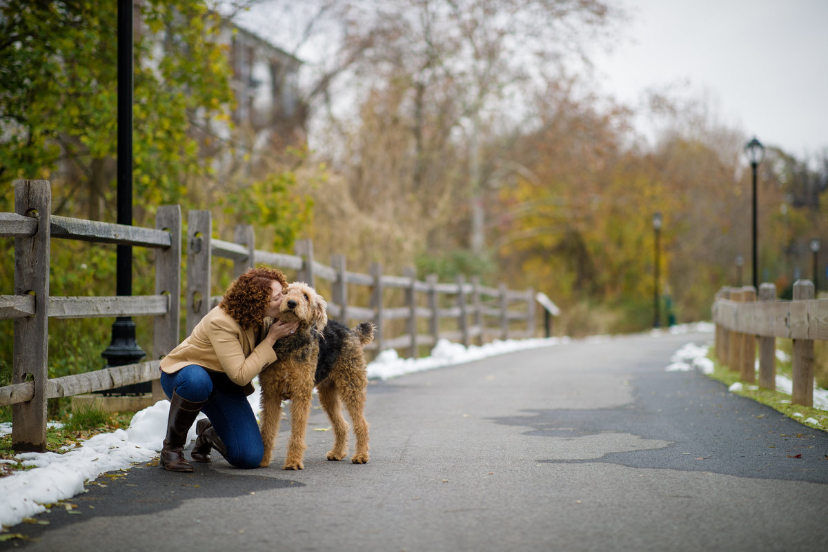 airedale gets kiss from mom at portrait session