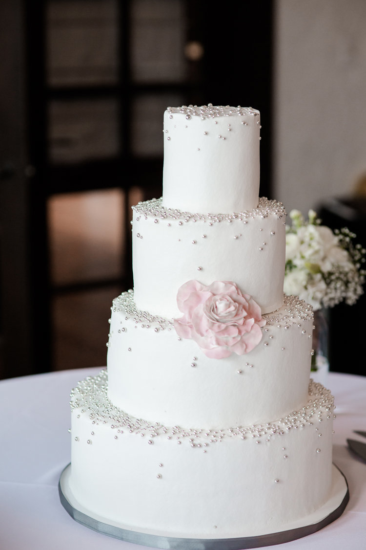 Sparkle wedding cake with floral accent