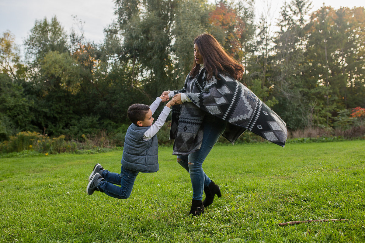 Mother twirling son outdoors  {Oakville Family Photographer}