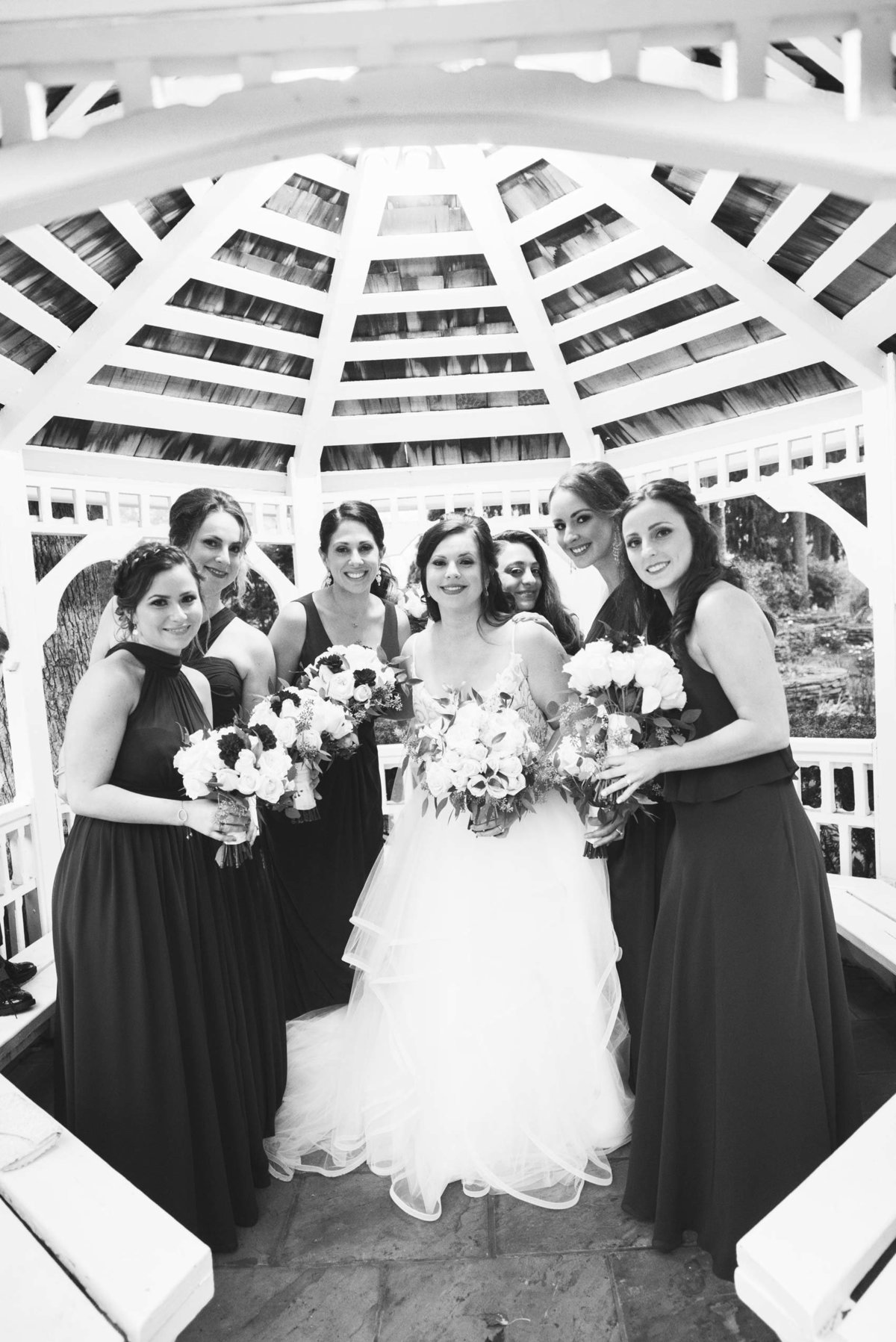 Bridesmaids photo with the bride at the gazebo of Fox Hollow