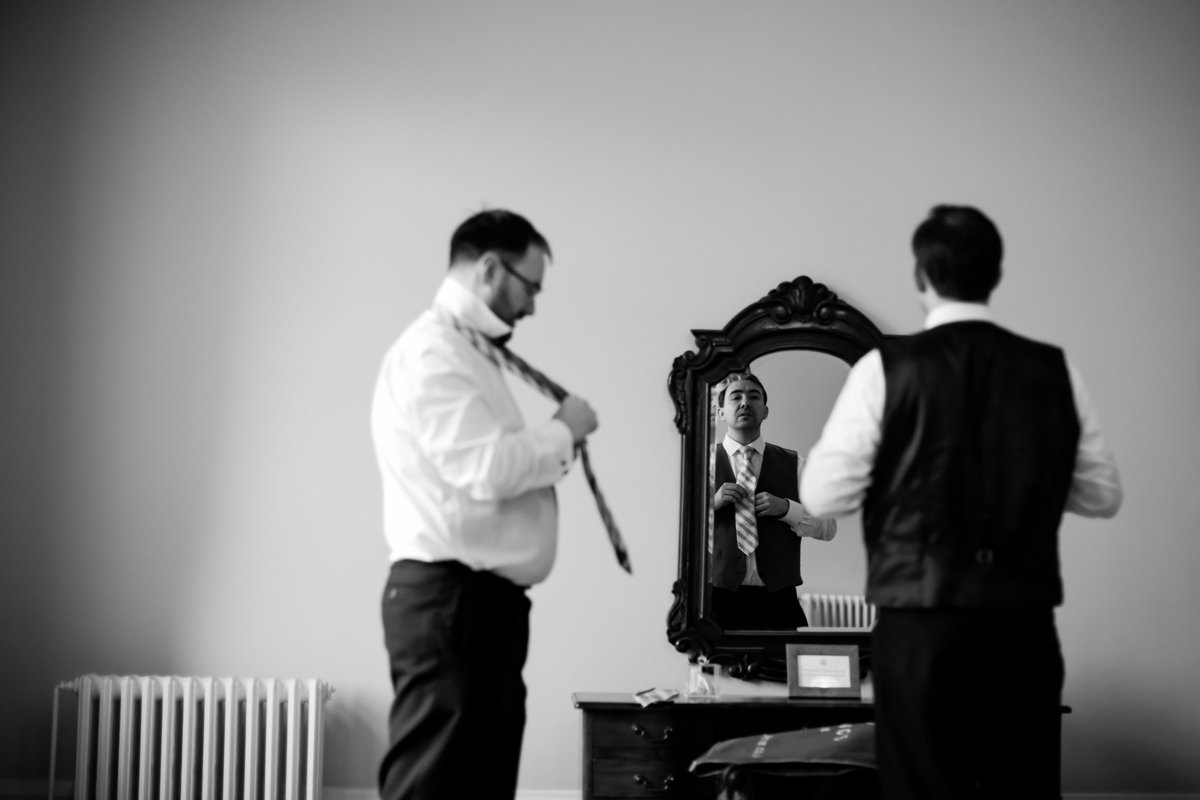 groom getting dressed at st audries park
