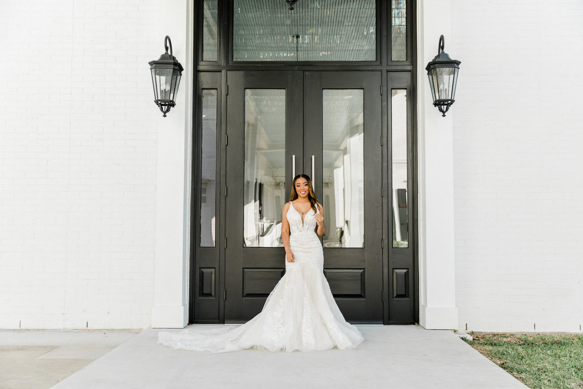 bride at sandlewood manor in front of doorss