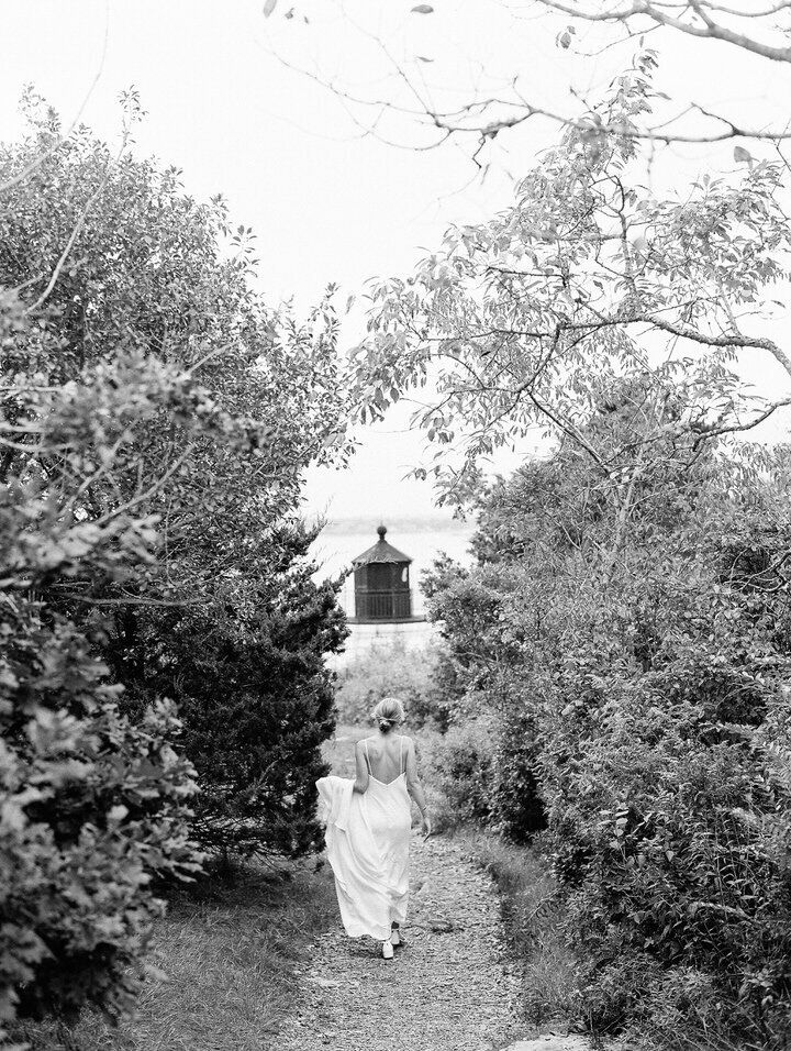 bride walking at castle hill lighthouse in newport rhode island