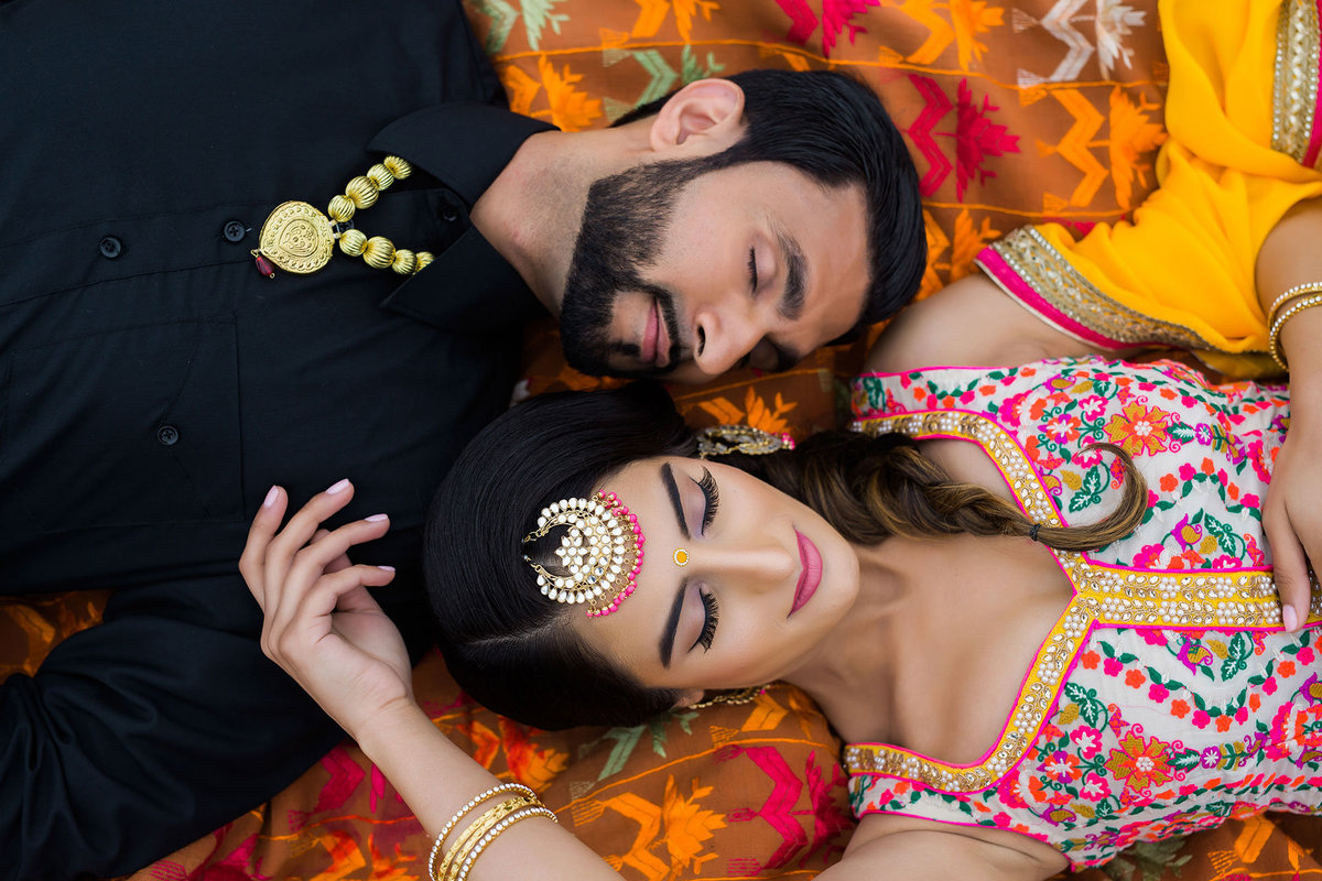 Punjabi couple laying together